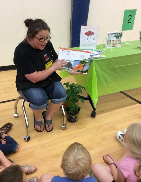 Ms. Cook from Ace Hardware of East End sharing information about plants.
