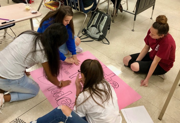 Students working on a poster