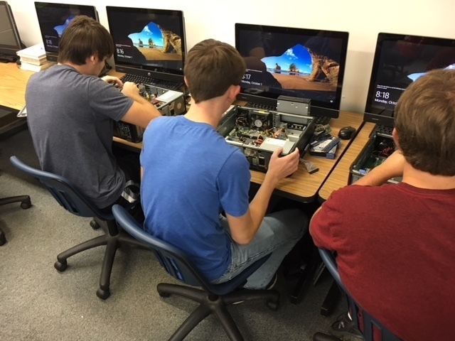 students taking computers apart