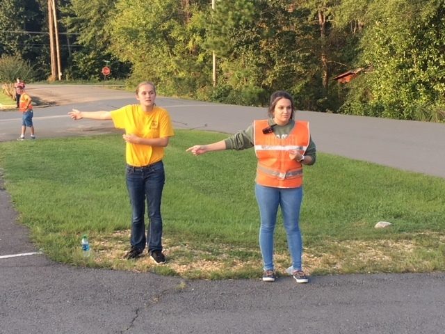 students directing traffic