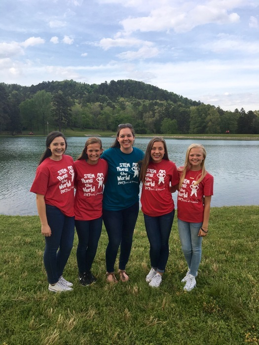 four students and their teacher at the STEM Girls of Promise Convention