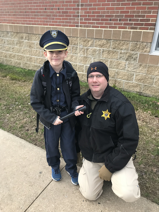 Image of police officer and student