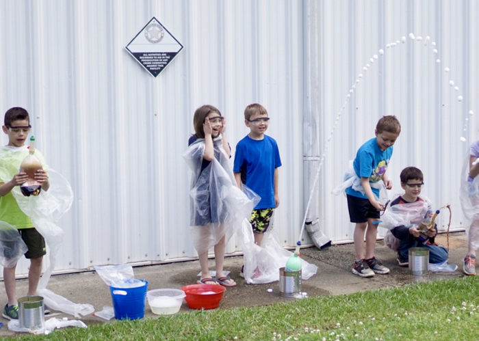 Kids conducting an experiment