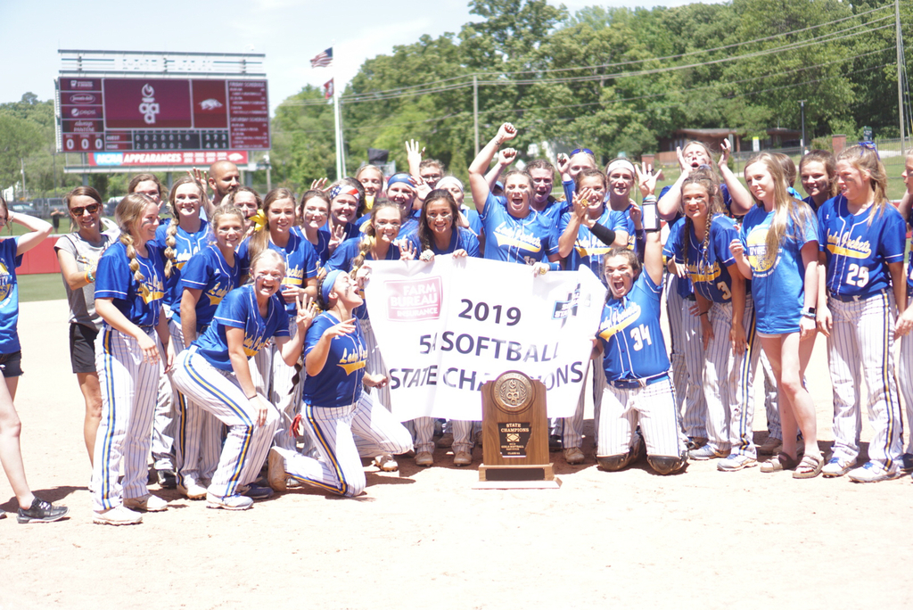 Image of softball team with their trophy