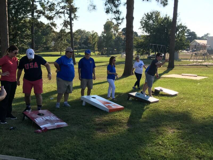 staff playing baggo before the football game at staff tailgate