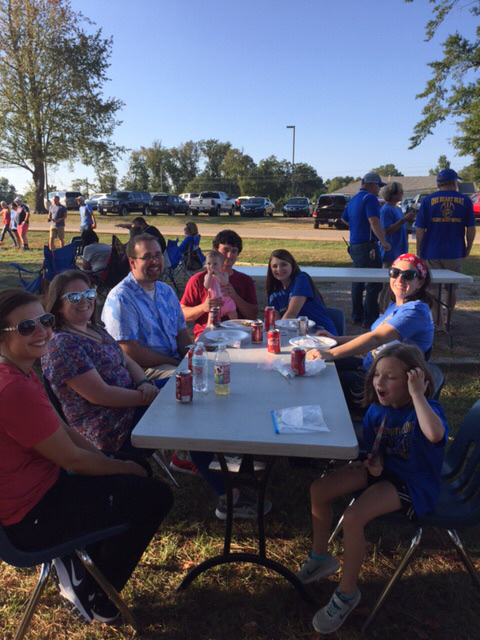 SHS Faculty at table at the staff tailgate