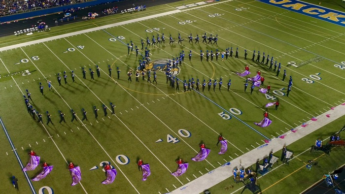 Aerial shot of the marching band at a football game
