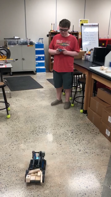 Peyton Varnell with his VEX Robot.