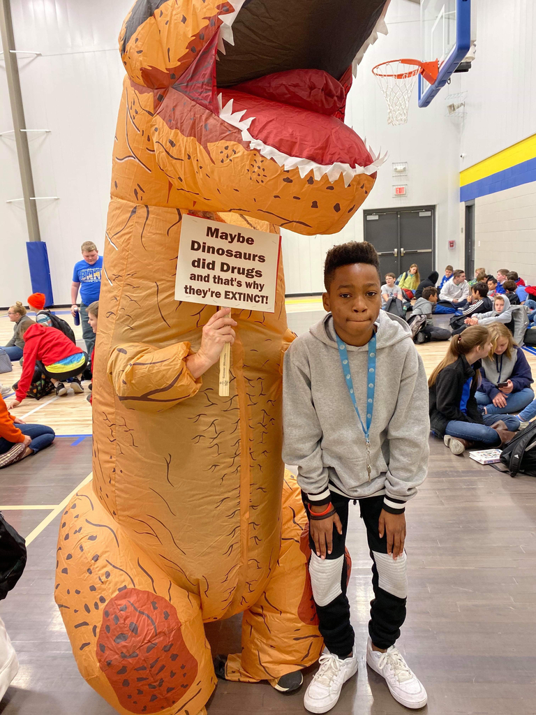Picture of student with dinasour