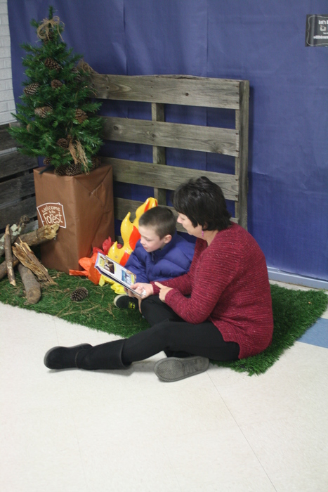 Child reading with a teacher