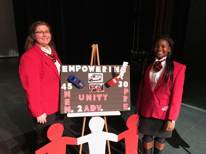 FCCLA Officers posing by poster