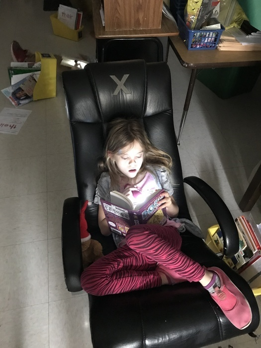 Student reading with flash light
