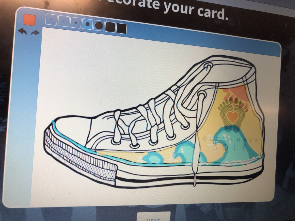 Creating cards to be delivered with the shoes.