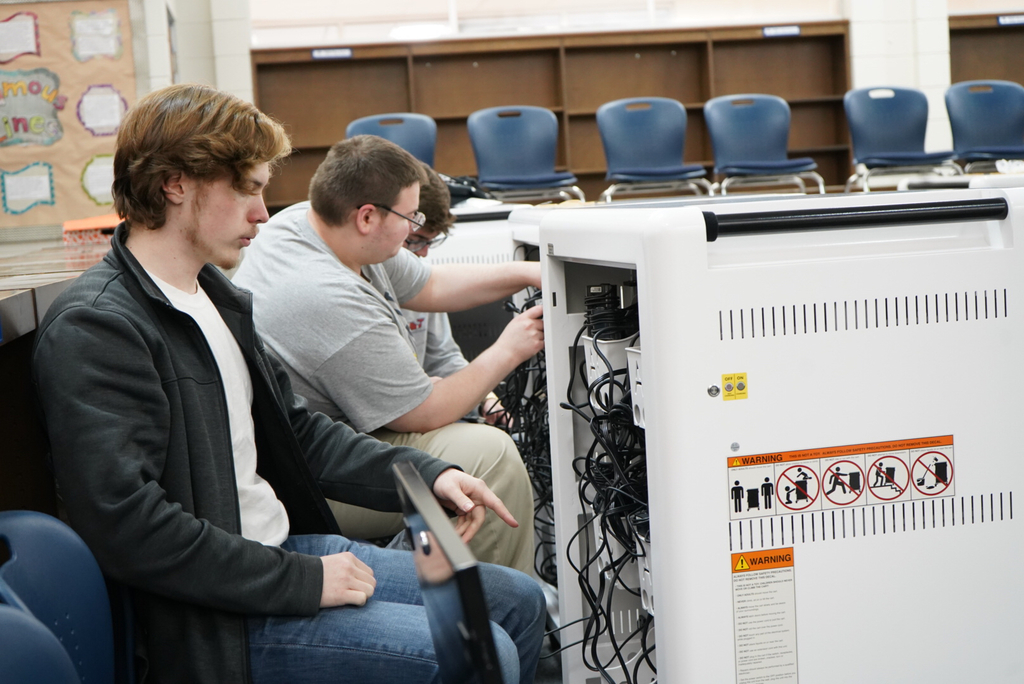 Students wiring Chromebook cart