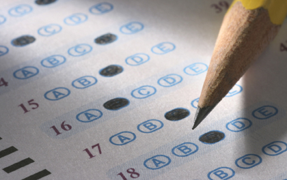 standardized test answer sheet with pencil filling in answer bubble
