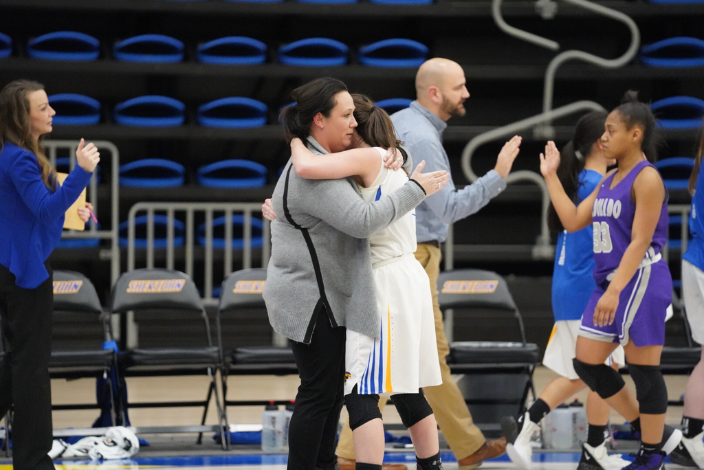 Picture of player hugging coach