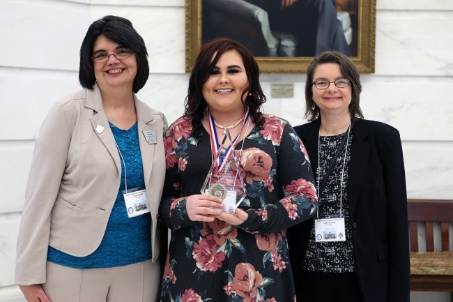 Addison Cheek receives award at the Captiol