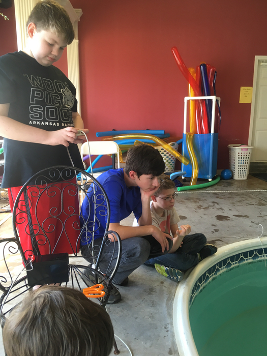 Kids working on underwater robot