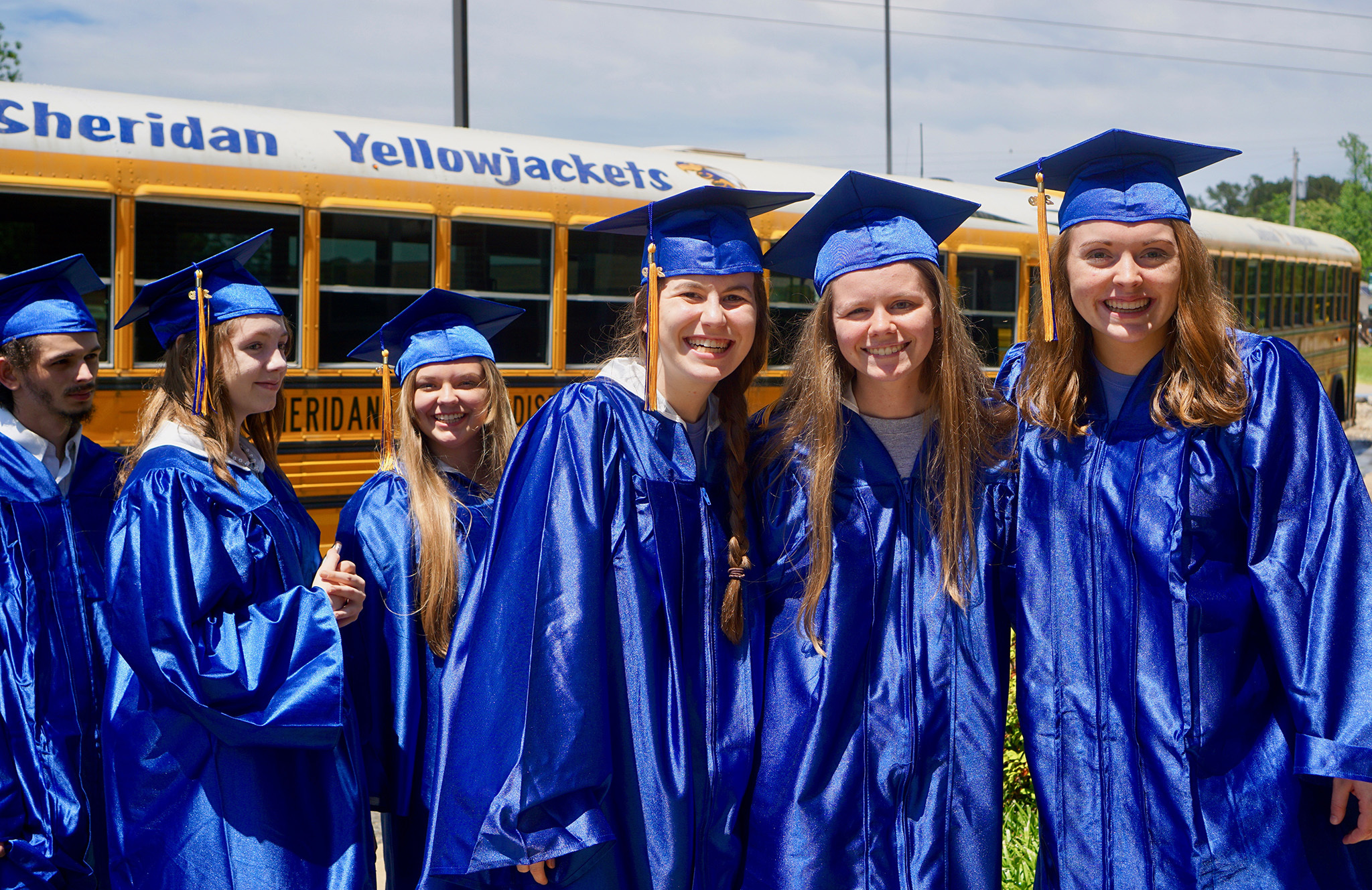 Grads in front of bus