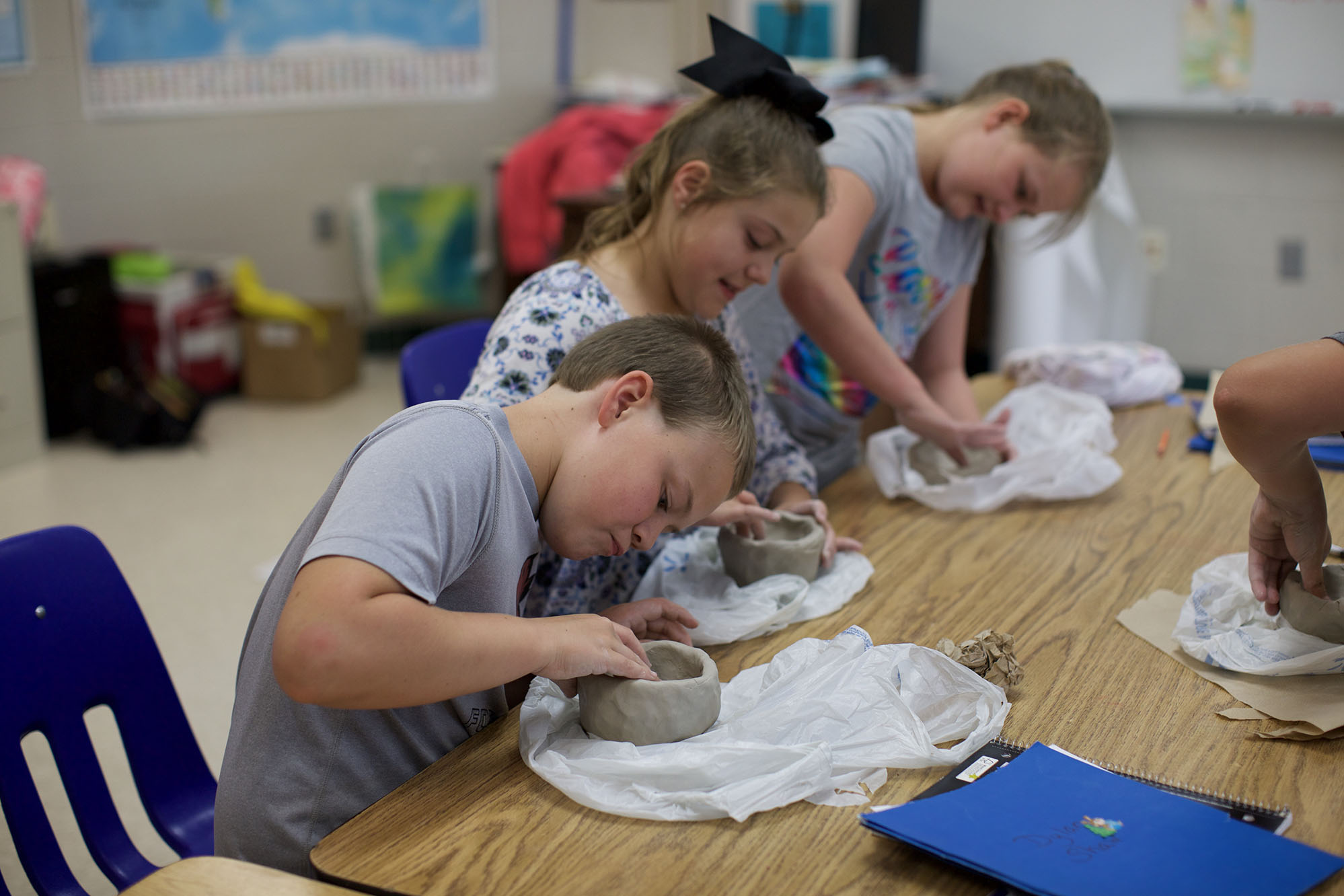 EEI 4th graders enjoying learning about functional pieces that are important to various civilizations & creating a pinch pot from clay.