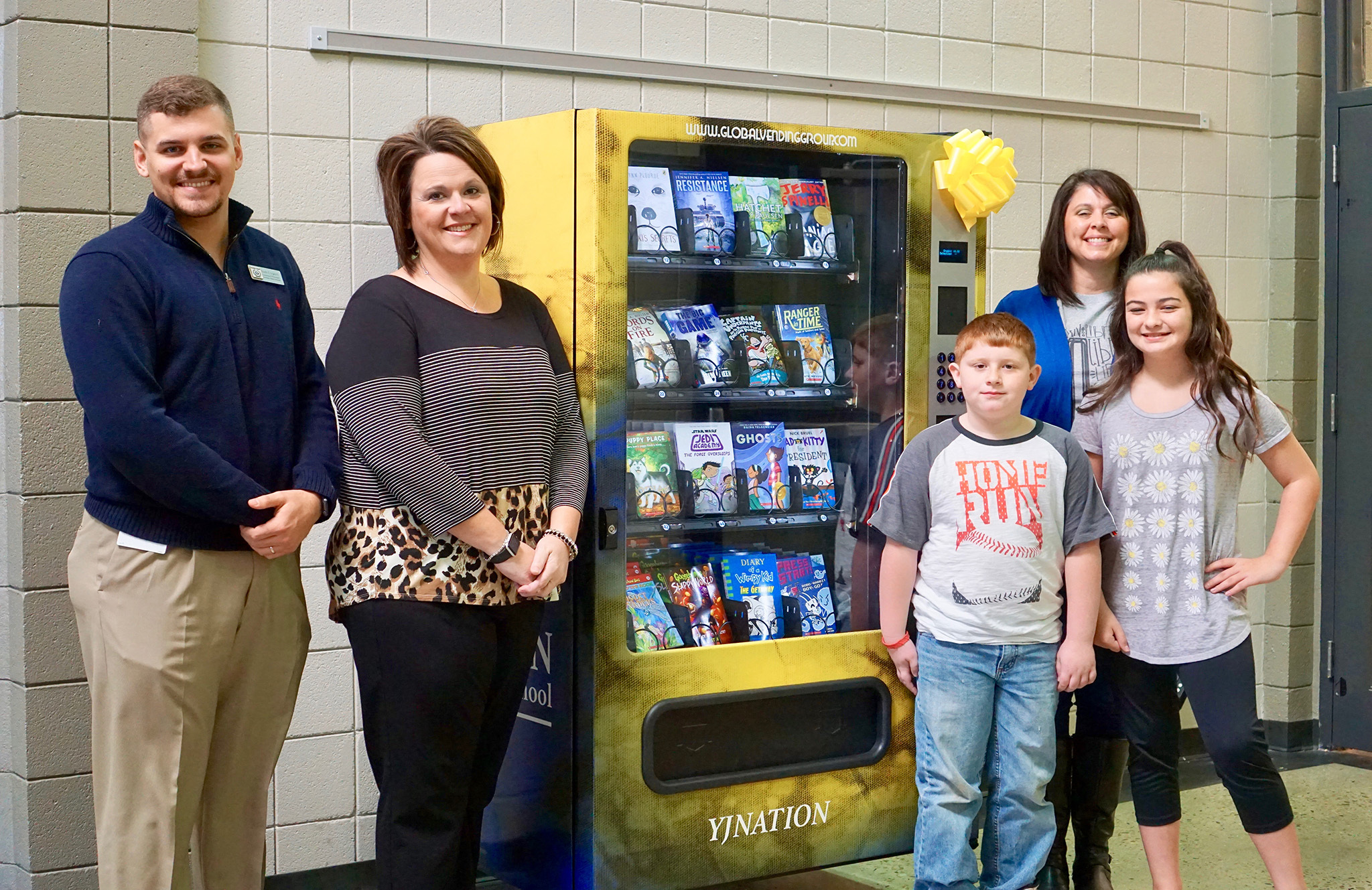 Students try out the new book vending machine