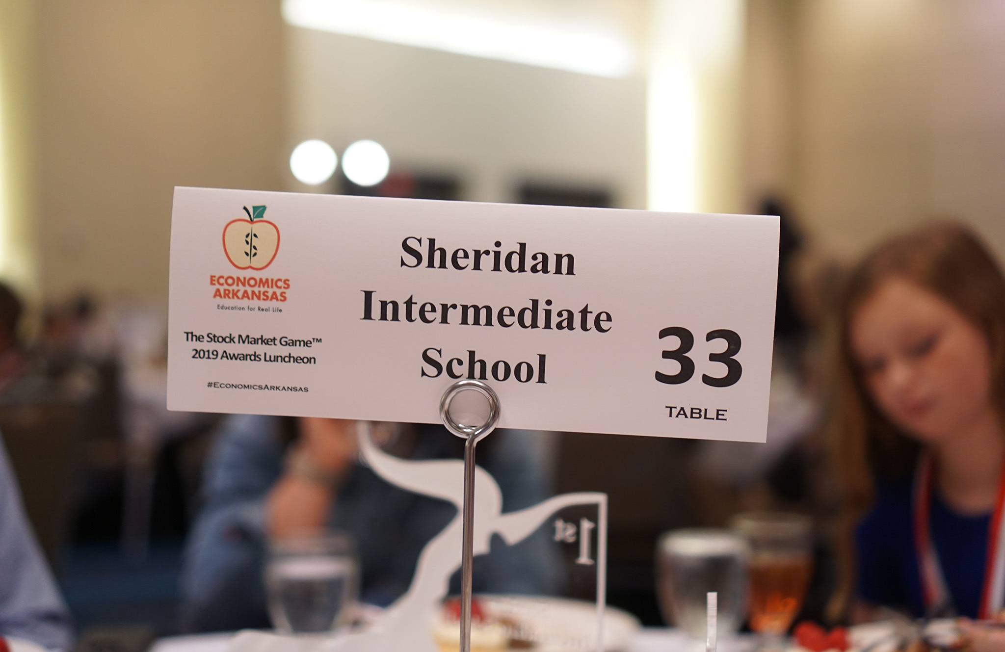 Table tag that says SIS at the Stock Market Awards Luncheon