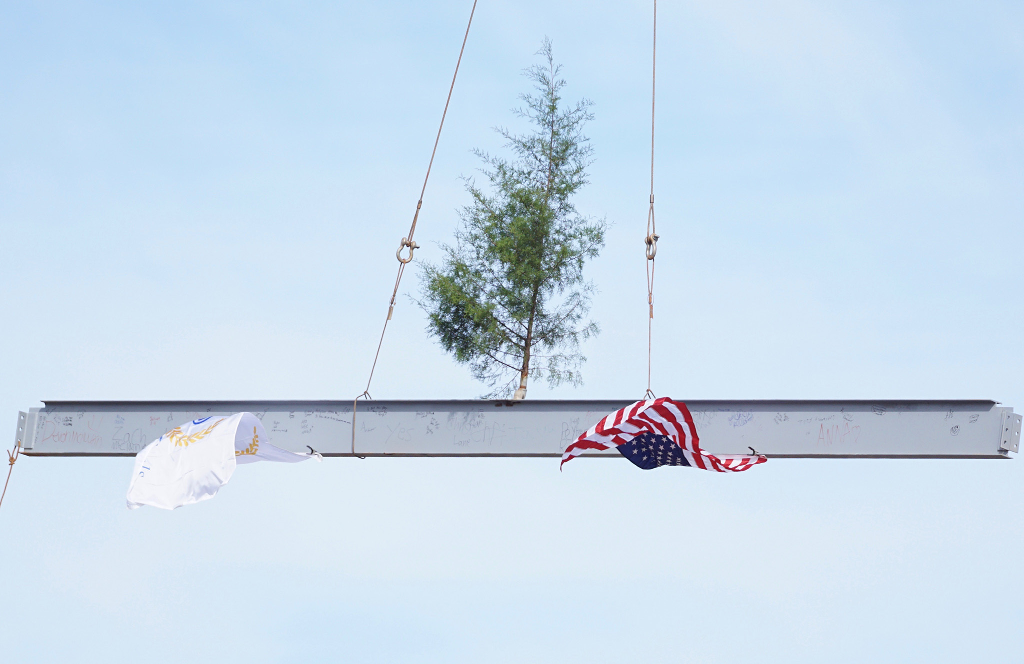 Picture of last beam placed on top of new building