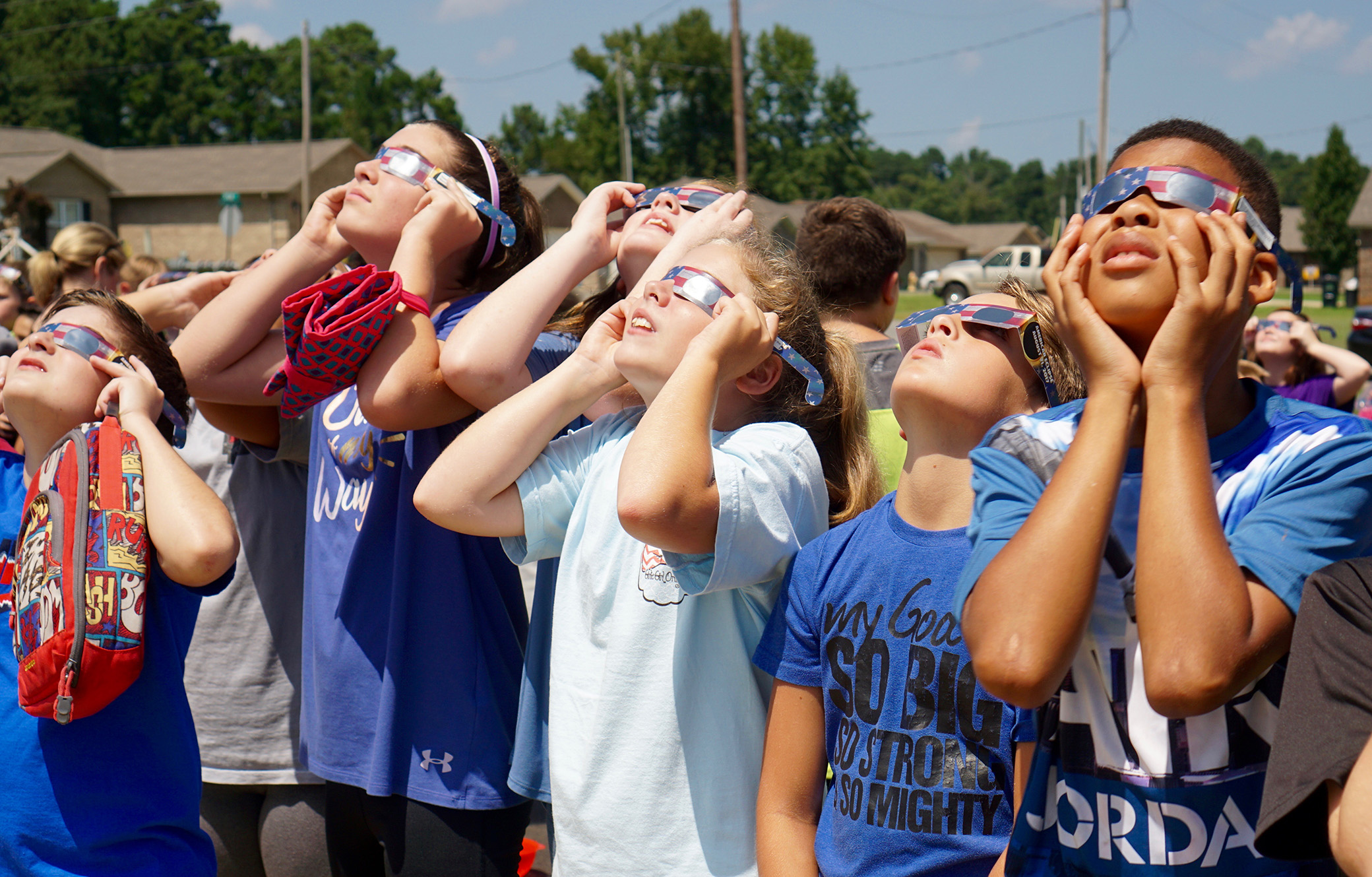 Students view the solar eclipse with NASA approved glasses
