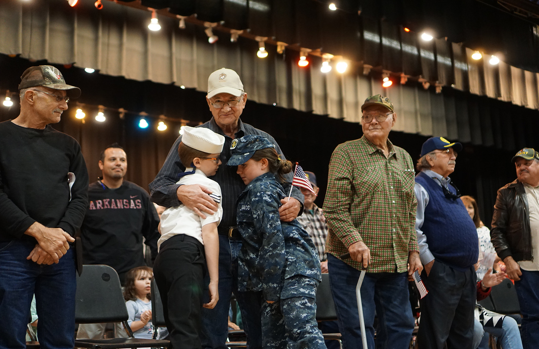 Veterans hug SIS students