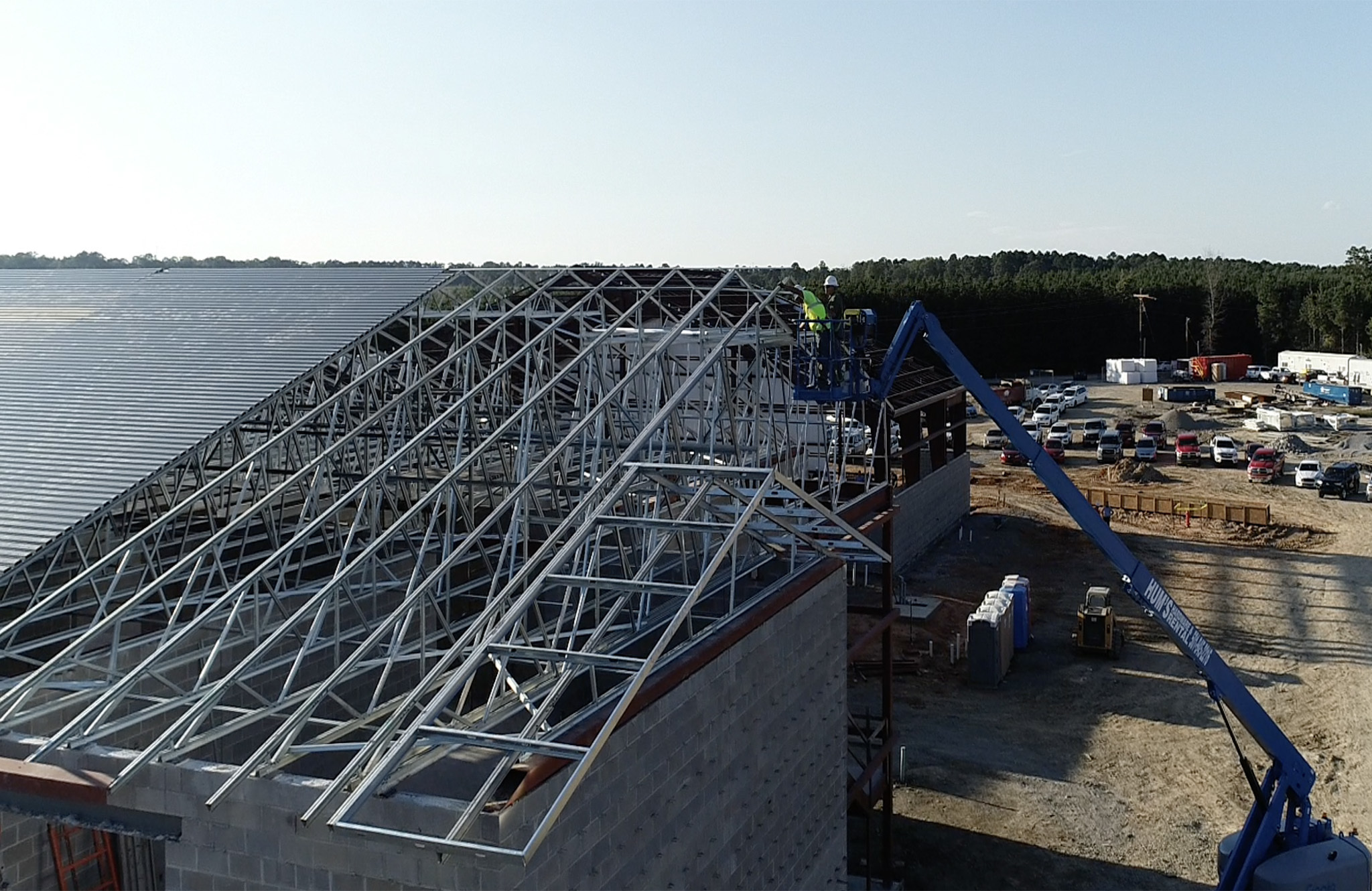 Image of the last truss being placed on top of the East End Middle School Building during construction