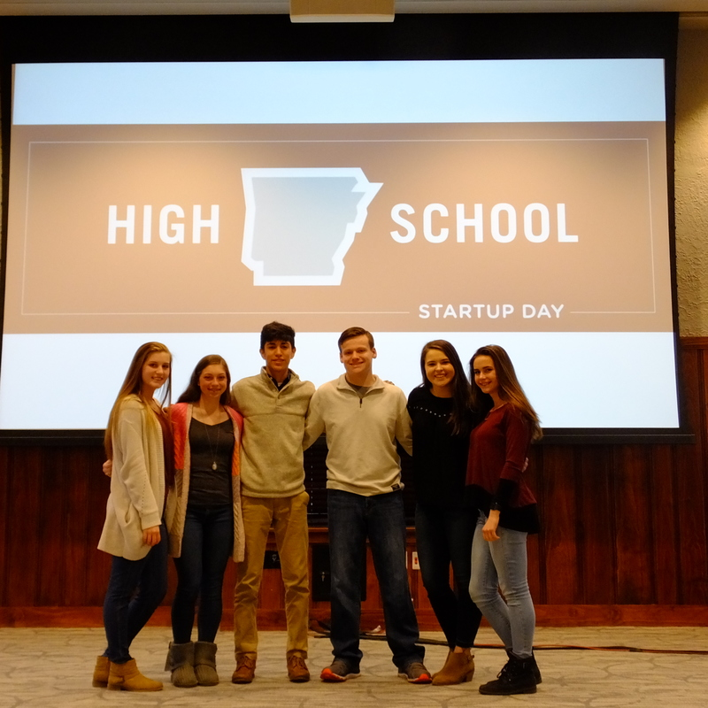 The six students smile for a picture after their big win at the High School Start-up day competition.